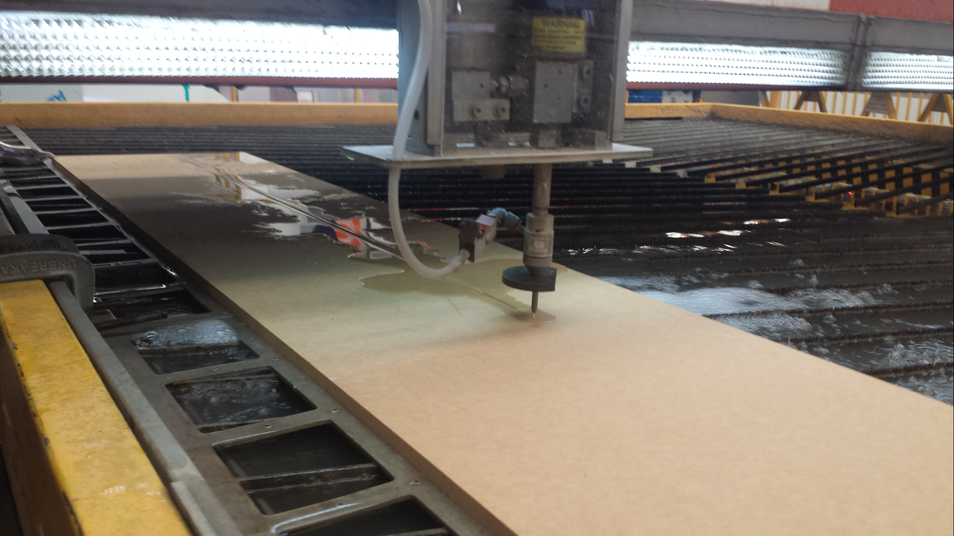 waterjet cutter in action